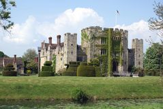 British castle with a bridge and a topiary garden at a riverside Stock Photos