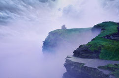British castle. British mystical atmosphere of the castle in the mist over the precipice Royalty Free Stock Photography
