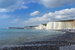 British chalk cliffs. Bathers under the white chalk cliffs stock image