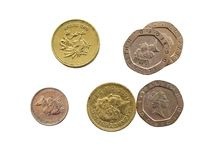Golden pounds and tin pennies. British cions on isolated background royalty free stock photography