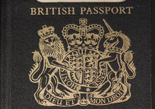 British coat of arms on a passport. Detail of the coat of arms, Dieu et mon droit , old style (pre EU) British passport Royalty Free Stock Images