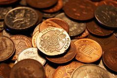 British coins. Collection of British coins, focussed on a twenty pence piece stock photos