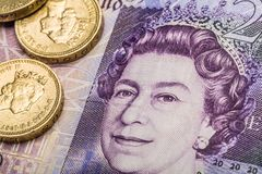 British Coins on Banknotes royalty free stock photos