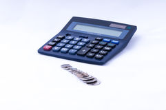 British coins and calculator dof Royalty Free Stock Image
