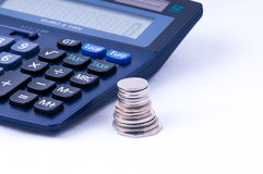 British coins and calculator side view Stock Images