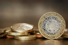 British Coins. Over blurred background.  One and two pound coins Stock Photos