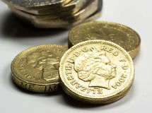British Coins - Stock Image. British coins. Focus on one pound portrait of Her Majesty Queen Elizabeth II, designed in 1998 by Ian Rank-Broadley. This design is Royalty Free Stock Images