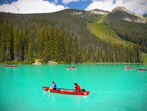British Columbia, Canadian Rockies, Attractions. Emerald Lake - Tourists in kayaks on lake and mountains view. Canadian Rockies. British Columbia, Canada Royalty Free Stock Image