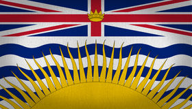 British Columbia flag. Divided in two sides in the top a british flag with a golden crown in the center and other side at the bottom with undulated waves in Royalty Free Stock Images