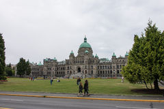 British Columbia Parliament Buildings, Victoria, Canada. People walking outside the British Columbia Parliament Buildings in Victoria, Canada on overcast day Royalty Free Stock Photo