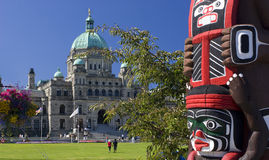 British Columbia Parliament, Victoria, Canada. British Columbia Parliament in Victoria with  totem in the foreground, Canada Stock Image