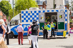 British  community support police officers chatting to members o. Leek, Staffordshire, England. - June 21st 2014 British  community support police officers Royalty Free Stock Images