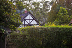 British Cottage. Traditional british cottage in the woods Royalty Free Stock Photography