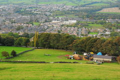 British countryside landscape: farm and tractors. Typical seasonal British landscape, Otley Yorkshire, with drywall fence and tractors in foreground, farm, sheep Stock Images