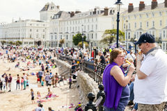 British couple eating ice pop and ice cream on a hot summers day. Llandudno, North Wales, United Kingdom. May 18 2014 : British couple eating ice pop and ice Royalty Free Stock Photos