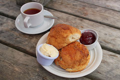 British cream tea. Traditional British cream tea served on a wooden board table Royalty Free Stock Photo