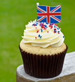 British cupcake. Home made cupcake with red white and blue sprinkles, topped off with a Union Jack flag Royalty Free Stock Photo