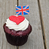 British cupcake. Home made cupcake with red white and blue sprinkles, topped off with a Union Jack flag Royalty Free Stock Images