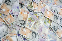 British currency. Pile of English currency spread out Royalty Free Stock Photo