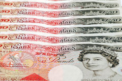 British currency. An image of a stack of British currency spread out royalty free stock photo