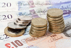 British Currency. British coins sitting on £20 and £10 pound notes Stock Image