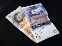 British currency. British paper money - £20 pound note and £10 note against black background.  english cash Stock Image