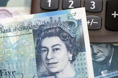 British Currency - Five Pound Note. London, UK: November 07, 2016: Close up of the new polymer five pound note with enhanced counterfeit resilience, showing the stock photos