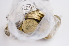 British Currency. Looking down into an open money bag of pound coins Royalty Free Stock Photography