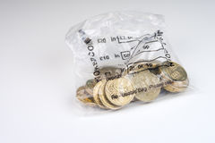 British Currency. A money bag of twenty pound coins Stock Photo