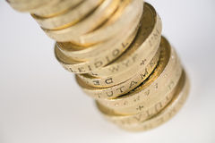 British Currency. A pile of pound coins on a table Stock Photography