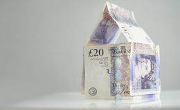British Currency. Property Investment. A house made of twenty pound notes Royalty Free Stock Photos