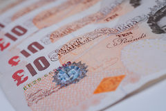 British Currency. Ten pound notes spread out on a table Royalty Free Stock Photography