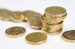 British Currency. A a toppled pile of pound coins on a table Stock Photography