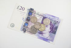British Currency. Twenty pound notes and coins on a table Royalty Free Stock Photography