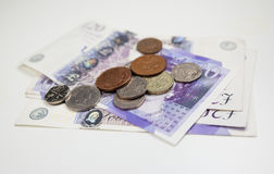 British Currency. Twenty pound notes and coins on a table Stock Photography