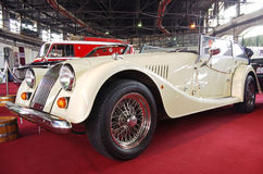 British custom car Morgan. BUDAPEST-APRIL 16: Classic British custom car Morgan Plus 4 in 'Royal Ivory' color on 4th Oldtimer Expo on April 16, 2010 in Budapest Royalty Free Stock Photos
