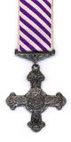 British DFC - Post 1919 Ribbon. A British (RAF) Distinguished Flying Cross with a post 1919 ribbon. Medals issued prior to 1919 were suspended from a ribbon with royalty free stock photography