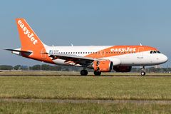 EasyJet. British easyJet Airbus A319-100 with registration G-EZGF just landed on runway 18R Polderbaan of Amsterdam Airport Schiphol stock photography