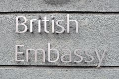 British embassy sign on grey wall Stock Photography
