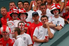 British Fans supporting the world soccer games wide. British soccer team supporters spending their holidays at the island of Mallorca meet to watch together Stock Image