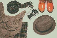 British fashion style women outfit with vintage film camera Royalty Free Stock Image
