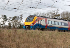 British fast train in motion. ST ALBANS, UK - MARCH 6, 2017: British East Midlands train in motion Royalty Free Stock Images