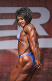 British Female Bodybuilder Shines in Toronto Contest. British female bodybuilder Wendy McCready displays formidable triceps, deltoids, traps, glutes, and Stock Photography