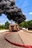British fire truck in attendance at large fire Royalty Free Stock Images