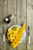 British Fish and Chips on a newspaper print plate Royalty Free Stock Photos