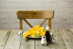 British Fish and Chips on a newspaper print plate Royalty Free Stock Photography