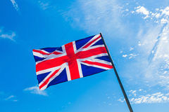 British flag. Against the blue sky royalty free stock photo