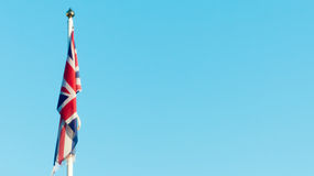 British flag against blue sky Stock Photography