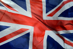 British Flag. Background Of British Union Jack Flag In The Wind royalty free stock photo