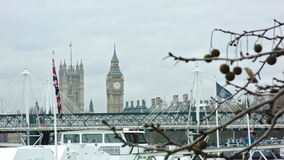 British Flag with Big Ben. Landscape with Hungerford Bridge in cloudy weather stock video footage